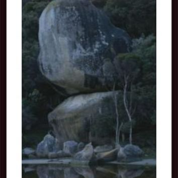 Huge Granite Boulders Encrusted In Lichens, framed black wood, white matte