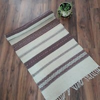Handwoven wool rug in off-white, brown and ashes of roses, striped and geometric boho rug for your home decor by Rugs N' Bags