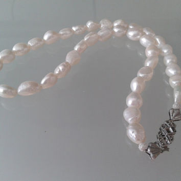 Necklace handmade with white baroque pearls and  vintage clasp in silver color