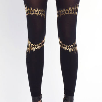 NEW--- Solaris, gold on black leggings, one size the Harmony collection