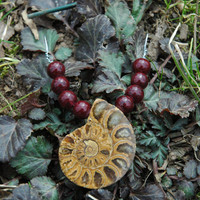 Ammonite Fossil and Red Glass Bead Pendant with Dark Brown Leather Cord