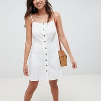 ASOS DESIGN Button Through Linen Mini Sundress at asos.com