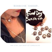 Sunshine choker. Summer 2015. Grunge chokers. Leather and Sun with face, silver charm. Loved on Tumblr. Teen and Women. Layer many.