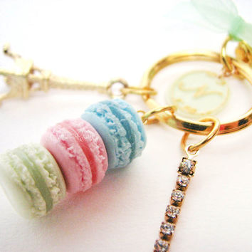 Laduree green alphabet charm with eiffel tower, a trio of macarons and a swarovski elements crystal chain hanging from a trigger snap clasp
