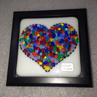 Velvet lined black wooden box with handcut fused glass multicolored pebble heart