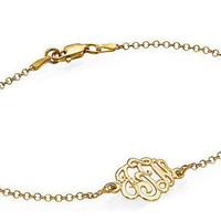 Monogrammed Bracelet made out of 18k Gold Plating over 0.925 Sterling Silver and hangs on an 18k Gold Plated Rollo Chain
