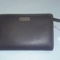 Gently used & Greatly loved brown Coach wallet