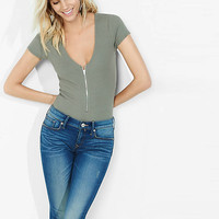 Express One Eleven Ribbed Zip Front Bodysuit from EXPRESS