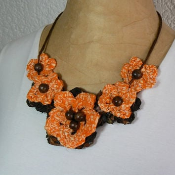 Handmade necklace bib with crochet flowers