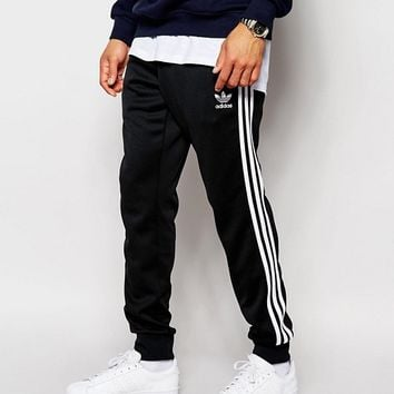adidas Originals Superstar Cuffed Track Pants AJ6960 at asos.com