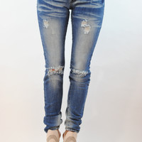(ann) Medium wash ripped knee jeans