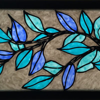 Glass painting with blue leaves