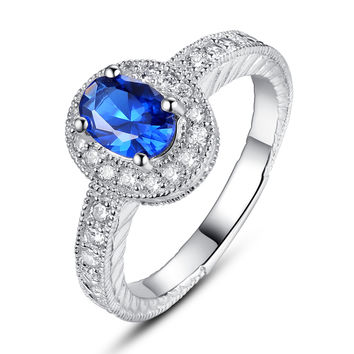 Sterling Silver Blue Oval and Clear Round Cubic Zirconia Halo Engagement Ring