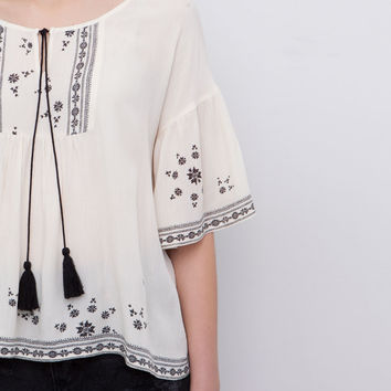LARGE ETHNIC BLOUSE WITH POM-POMS - BLOUSES AND SHIRTS - WOMAN - PULL&BEAR Singapore