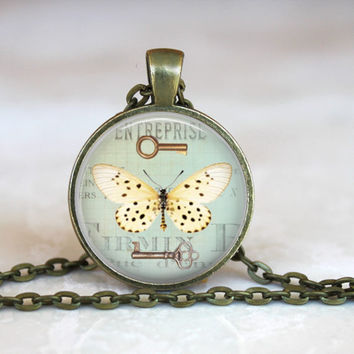 Pastel butterfly with key pendant necklace, altered art pendant necklace.  Mint green, yellow moth, butterfly jewelry
