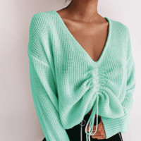 The new loose-fitting v-neck pleated sweater lady
