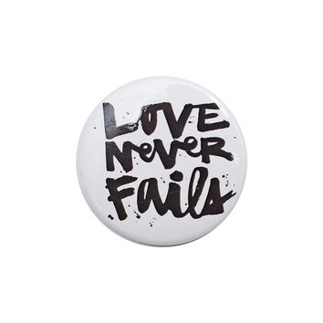 Love Never Fails White Button