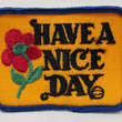 HAVE a NICE DAY. red flower. jacket or shirt patch.