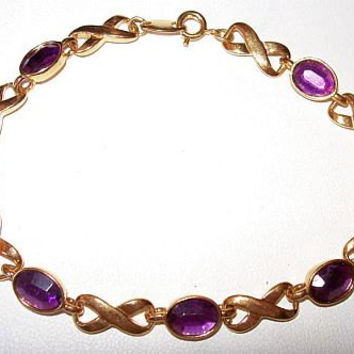 "Hugs Kisses Bracelet Purple Rhinestones Signed AVON Tennis Link Style Gold Metal 8"" Vintage"