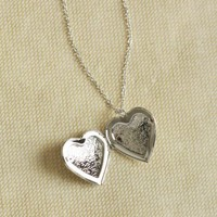 heart of silver locket necklace at ShopRuche.com