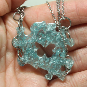 Tiny Puzzle pendants 4 piece set light blue with silver metal flakes