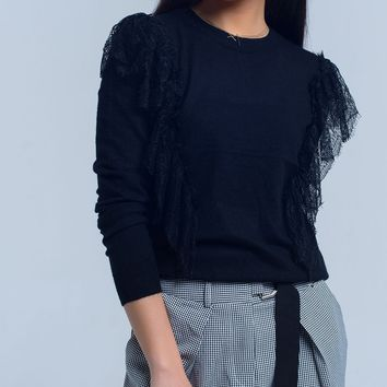 Black sweater with crochet ruffles