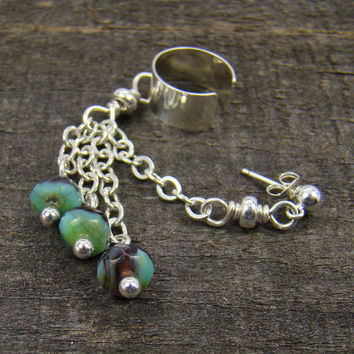 Silver ear cuff with faceted glass bead dangles and piercing, sterling chain