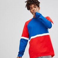 ASOS Longline Long Sleeve T-Shirt With Bright Colour Block at asos.com