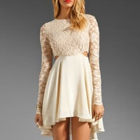 Donna Mizani Cut Out Flounce Dress in Nude/Nude from REVOLVEclothing.com