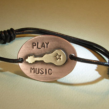 Leather wrap bracelet with bronze guitar on copper