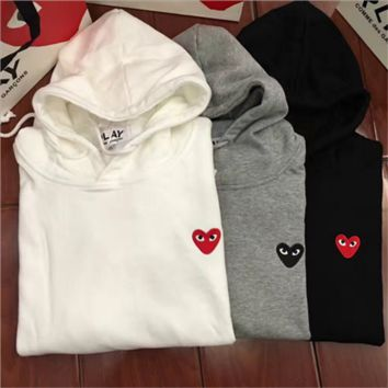 Autumn and winter tide couple lovers with red velvet hooded sweater