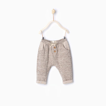 PLUSH TROUSERS WITH SMALL BOW