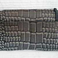 Clutch outside double pocket crocodile skin design, closed with a zip, shinny black, grey, gold brown glints, casual chic
