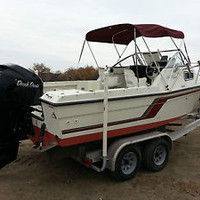 1995 celebrity 23ft with center console, cuddy cabin. 225 mercury out board