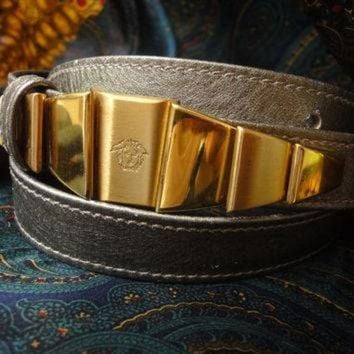 CREY1O Vintage Gianni Versace skinny gold bronze leather belt with golden hardware and medusa