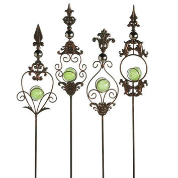 Shop Glass Garden Stakes on Wanelo