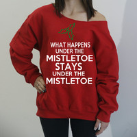 What Happens Under The Mistletoe Stays Under The Mistletoe. Slouchy oversized sweatshirt. Christmas sweatshirt. Holiday shirt.