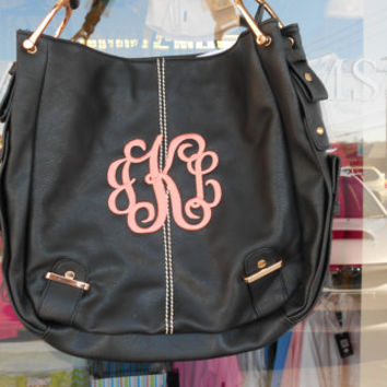 MONOGRAM Black Colored Purse Leather like Font shown INTERLOCKING in coral
