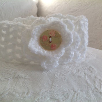 Cute crocheted white headband.