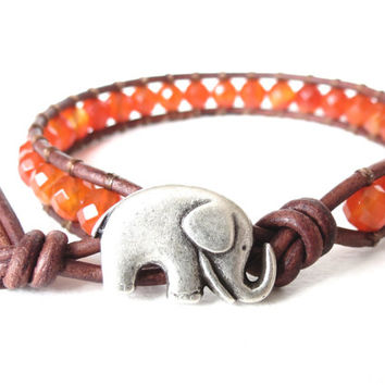 Elephant bracelet hipster style with faceted burnt orange carnelian, Halloween color scheme