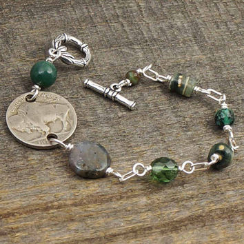 Green wirewrapped bracelet, US buffalo nickel coin jewelry, assorted green beads, silver, 7 1/4 inches