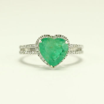 engagement emerald edwardian and shaped ring heart halo diamond front