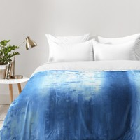 Madart Inc. Blue Lake Comforter | DENY Designs Home Accessories