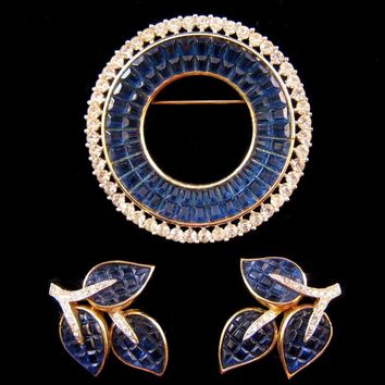 1950s Trifari Invisibly Set Faux Sapphire Circle Pin and Leaf Earrings