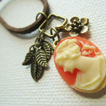 60% OFF Buttercups and Kisses Necklace - coral cameo, flower charm, and leaf charms on a brown suede cord