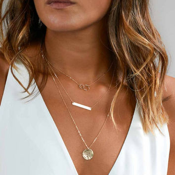 Silver Layered Disc, Bar, and Double Ring Chain Necklace