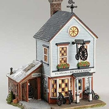 "Department 56 New England Village Series ""P.L. Wheeler's Bicycle Shop"" #56.56613"