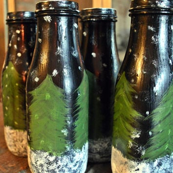 Painted glass bottles winter scene pine trees and snow on bottle handcrafted home decor winter table decor seasonal hand painted glass jars