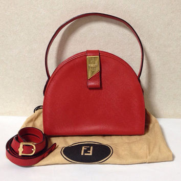 Vintage Fendi red woven embossed leather hand bag purse with shoulder strap. Oval shape. Matching mirror.