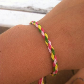 Handmade pink yellow an green string twist friendship bracelet